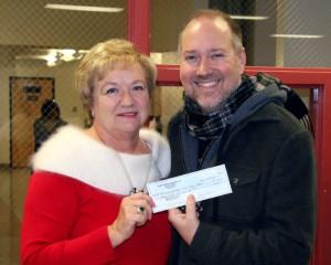 Marsha Jackson presents Mr Brett Carroll with the Club's Yearly donation Burbank Vocal Music